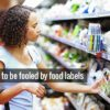 Woman reading food label on product in the supermarket